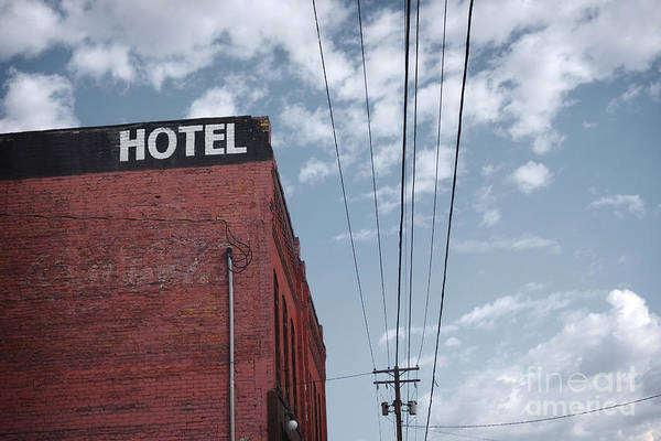 Telephones Wall Art - Photograph - Old Dilapidated Brick Motel With Cloudy by J.d.s
