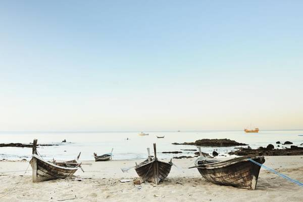 Fishing Boat Photograph - Old Fishing Boats On The Beach by Carlina Teteris
