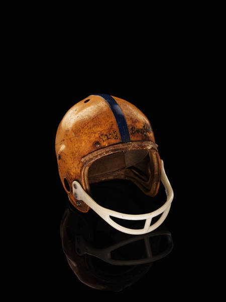 Football Helmet Photograph - Old Football Helmet On Black Background by Alexander Nicholson