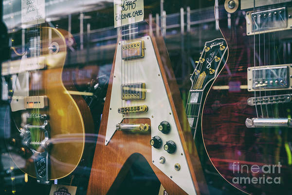 Photograph - Old Guitars In A Shop Window by Tim Gainey