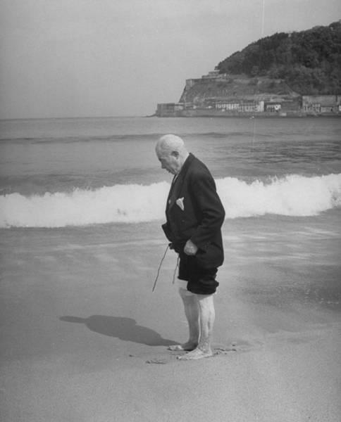Wading Photograph - Old Man Wading On San Sebastian Beach by Eliot Elisofon