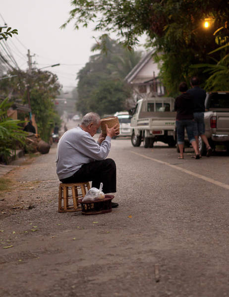 Senior Adult Photograph - Old Man Waiting For Monks With Begging by Cormac Mccreesh