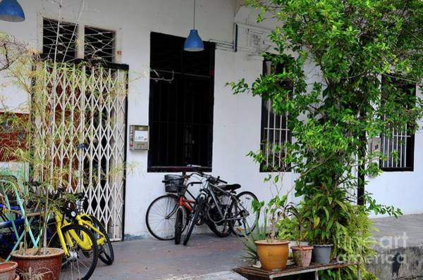 Photograph - Old Shop House With Bicycles And Windows On Pavement Kampong Glam Singapore by Imran Ahmed