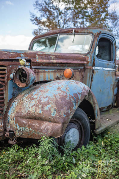 Wall Art - Photograph - Old Vintage Blue Pickup Truck Among The Weeds by Edward Fielding