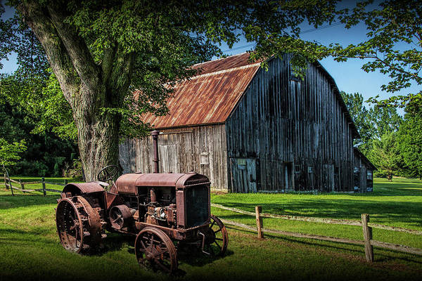 Wall Art - Photograph - Old Vintage Mccormick Deering Tractor With Old Weathed Barn by Randall Nyhof