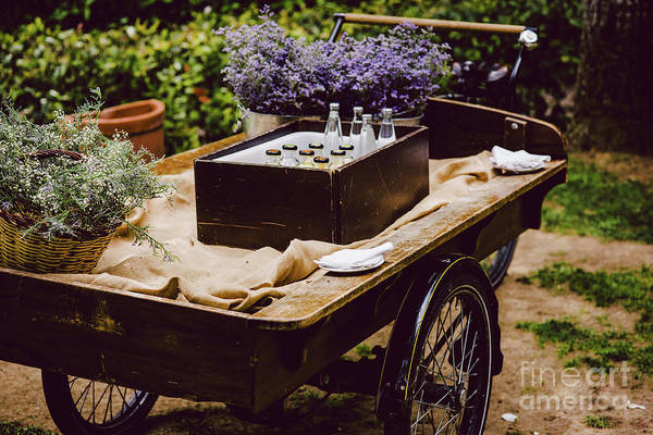 Photograph - Old Wooden Cart To Transport Goods Used For Decoration At A Wedding. by Joaquin Corbalan