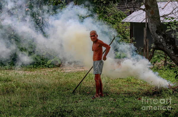 Wall Art - Photograph - Older Cambodian Male Fields Burning Weeds Look  by Chuck Kuhn