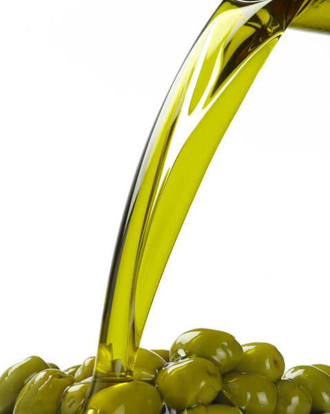 Wall Art - Photograph - Olive Oil Pouring Over Green Olives by Domino