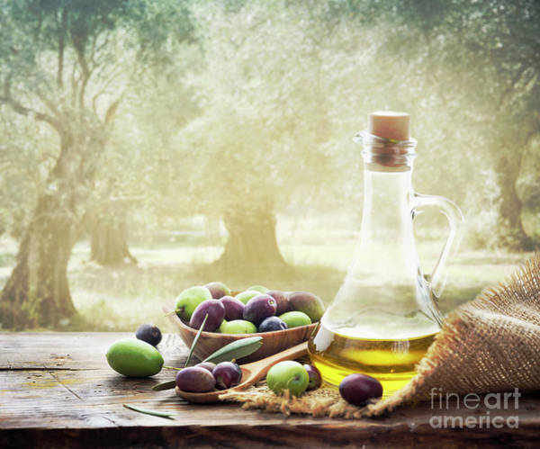 Wall Art - Photograph - Olives And Bottle Of Olive Oil On Wooden Table In Olive Garden by Jelena Jovanovic