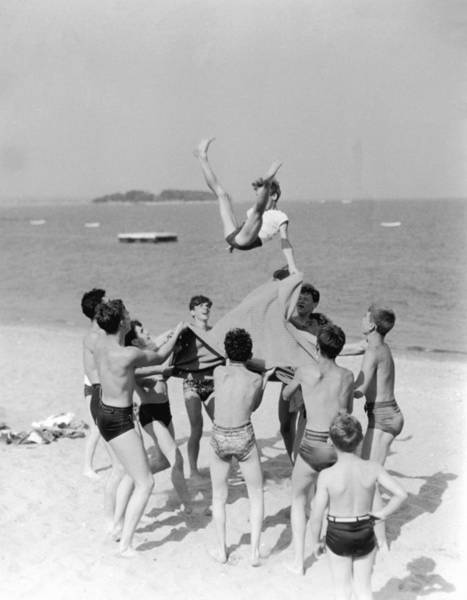 Playful Photograph - On The Beach by Archive Photos