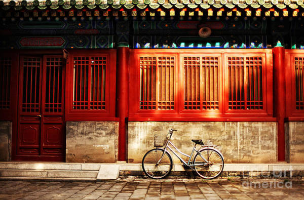 Wall Art - Photograph - One Bicycle In Front Of Oriental Red by N K