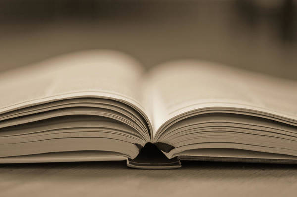 Open Photograph - Open Text Book by Simon Vogt