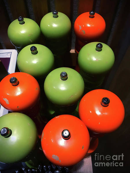 Wall Art - Photograph - Orange And Green Pepper Grinders by Tom Gowanlock