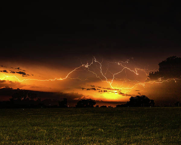 Photograph - Orange Lightning by Jay Stockhaus