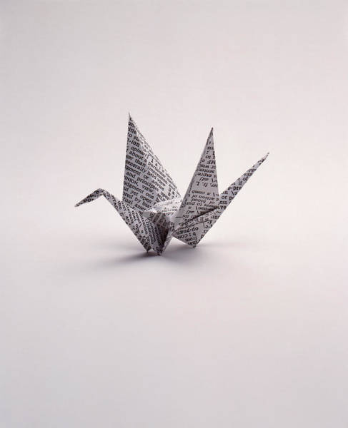 Newspaper Photograph - Origami Crane On White by Howard Sokol