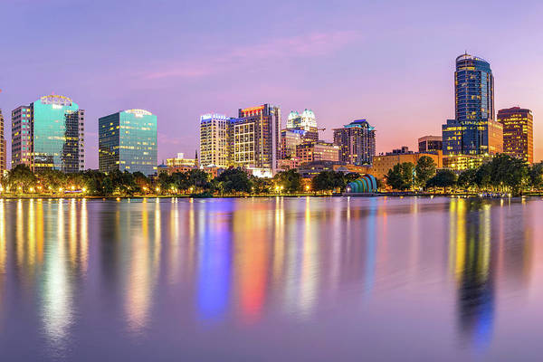 Photograph - Orlando Florida Skyline Reflections On Lake Eola by Gregory Ballos