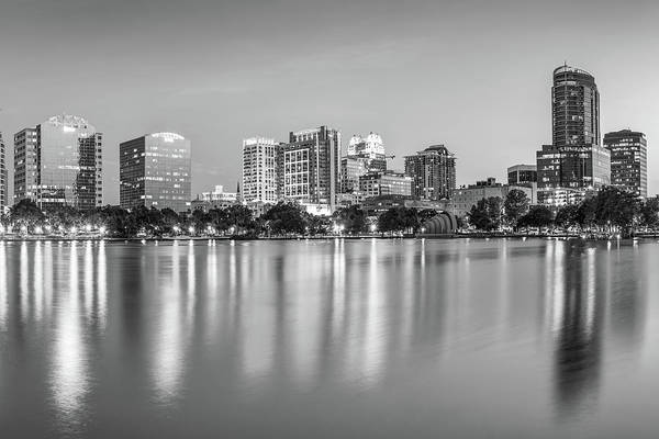 Photograph - Orlando Florida Skyline Reflections On Lake Eola - Monochrome Edition by Gregory Ballos