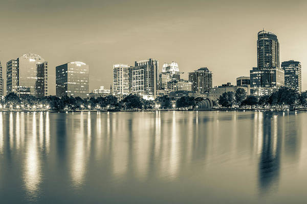Photograph - Orlando Florida Skyline Reflections On Lake Eola - Sepia Edition by Gregory Ballos