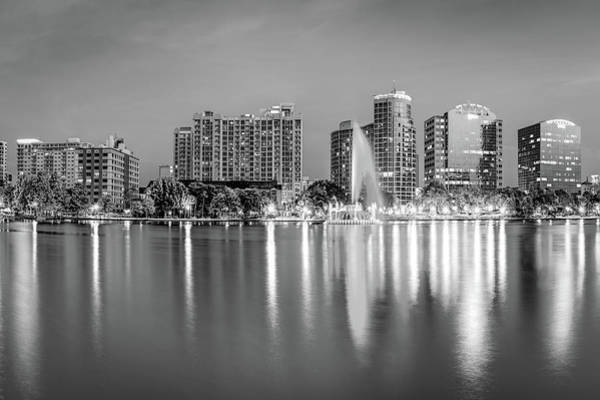 Photograph - Orlando Skyline And Lake Eola Fountain At Dusk - Monochrome by Gregory Ballos