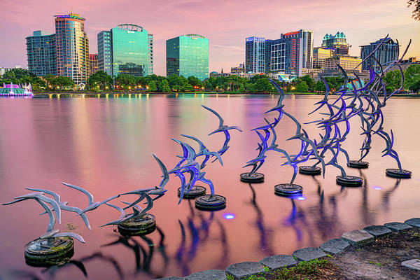 Photograph - Orlando Skyline And Take Flight Sculptures At Sunset by Gregory Ballos