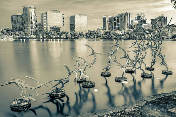 Photograph - Orlando Skyline And Take Flight Sculptures In Sepia by Gregory Ballos