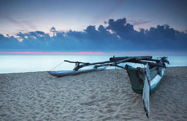 Outrigger Canoe Photograph - Oruwa Outrigger Canoe On Beach At by Ian Trower / Robertharding