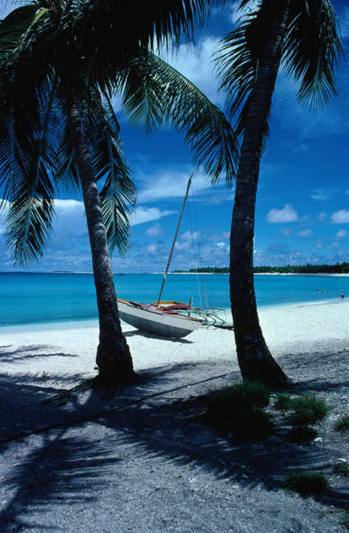 Outrigger Canoe Photograph - Outrigger Canoe On A Palm-fringed by Oliver Strewe