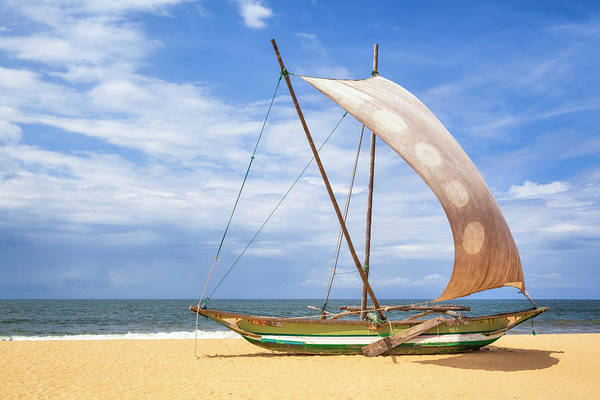 Outrigger Canoe Photograph - Outrigger Prahu Or Proa On The Beach In by Cinoby