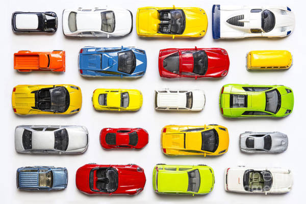 Wall Art - Photograph - Overhead View On Colorful Car Toys by Pirke