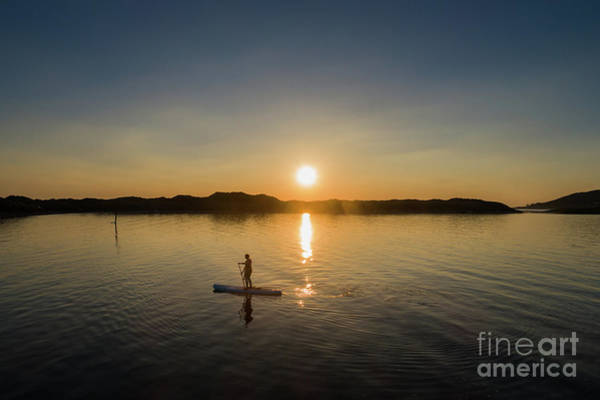 Photograph - Paddleboarding At Sunset by Keith Morris