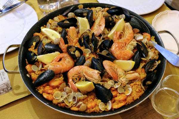 Wall Art - Photograph - Paella Pan With Seafood In A Restaurant Coastal Town Of Fano Marche Region Italy by imageBROKER - Uwe Kraft