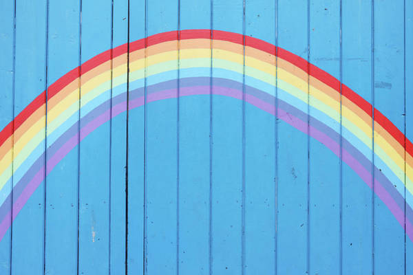 Fence Photograph - Painted Rainbow On Wooden Fence by Richard Newstead