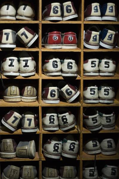Ten Pin Bowling Wall Art - Photograph - Pairs Of Bowling Shoes On A Shelf by Rubberball/mike Kemp