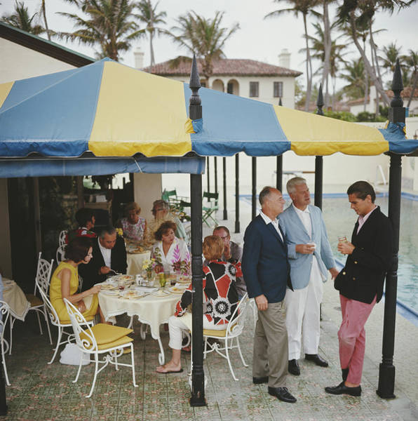 Sunshade Photograph - Palm Beach Party by Slim Aarons