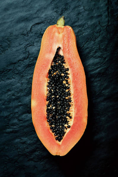 Wall Art - Photograph - Papaya Cross-section On Dark Slate by Johan Swanepoel