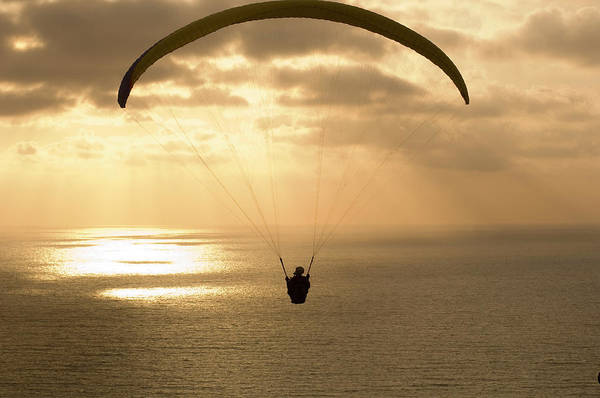 Wall Art - Photograph - Paraglider Flying In The Sky Over An by Panoramic Images