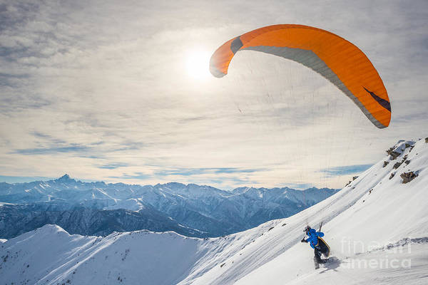 Event Wall Art - Photograph - Paraglider Running On Snowy Slope For by Fabio Lamanna