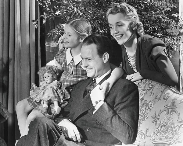 Laughing Photograph - Parents With Daughter 6-7 In Living by George Marks