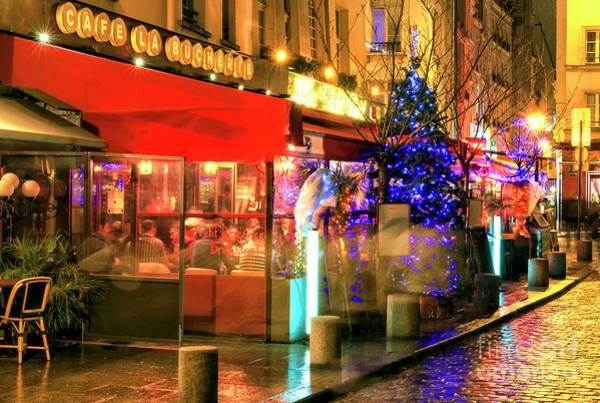 Photograph - Paris Cafe La Bucherie At Night by John Rizzuto