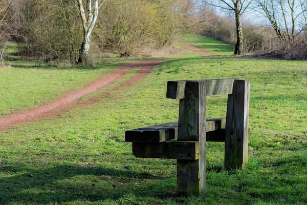 Photograph - Park Bench Beside Dirt Track by Scott Lyons