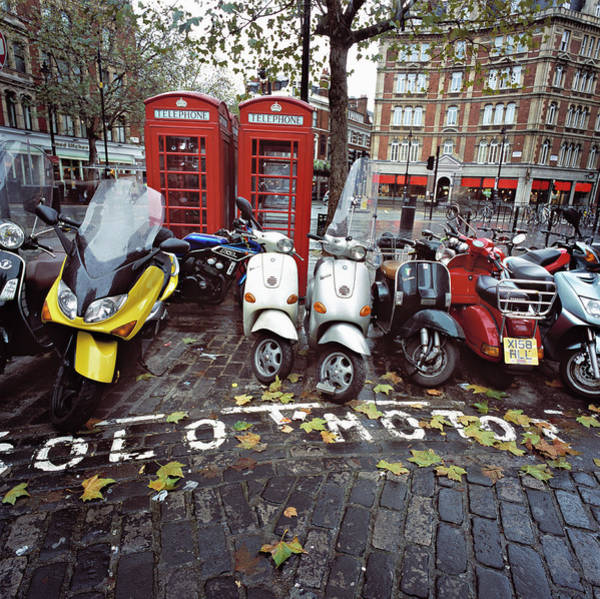 London Phone Booth Wall Art - Photograph - Parked Motorbikes And Scooters By Phone by Ghislain & Marie David De Lossy