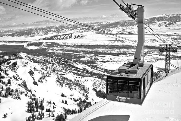 Photograph - Partly Cloudy Skies Over The Jackson Hole Tram Black And White by Adam Jewell