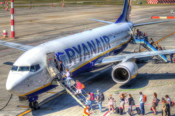 Wall Art - Photograph - Passengers Boarding An Aircraft by David Pyatt