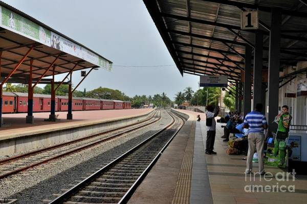 Wall Art - Photograph - Passengers Wait On Platform For Colombo Bound Train At Jaffna Railway Station Sri Lanka by Imran Ahmed
