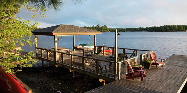 Patio Photograph - Patio Furniture On A Wooden Dock On A by Keith Levit / Design Pics