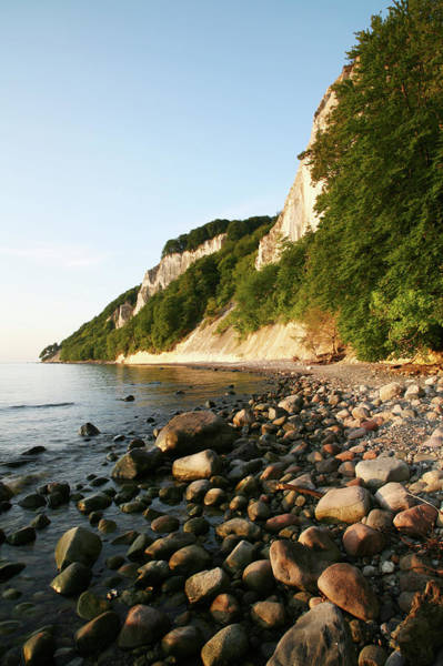 Waters Edge Photograph - Pebble Beach With Chalk And Mud Cliffs by Feargus Cooney