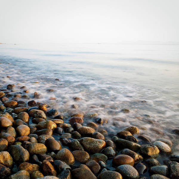 Sparse Photograph - Pebble Rocks On Beach by Visualcommunications