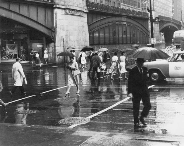 Station To Station Photograph - Pedestrians Hold Umbrellas by The New York Historical Society