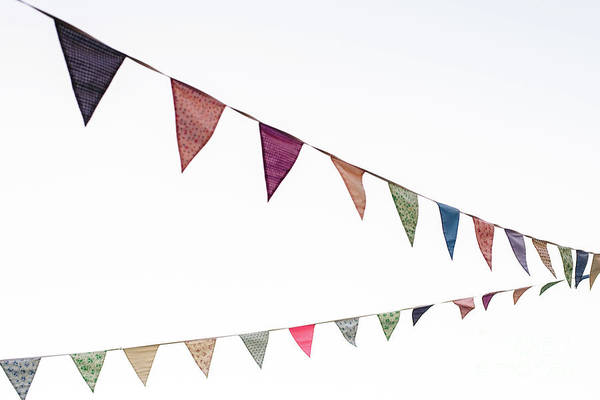 Photograph - Pennants With Blue Sky Background. by Joaquin Corbalan