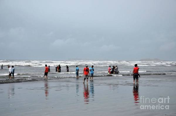 Photograph - People And Families Wade In Water And Enjoy The Waves At Sea View Beach Karachi Pakistan by Imran Ahmed